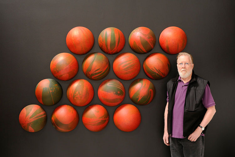 Photo of Adrian Saxe next to 4 squared - Chrome Crystalline Array, 1968